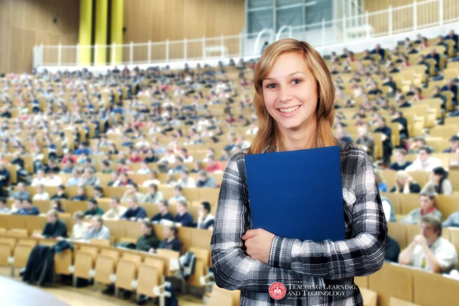 student in fron of a large lecture classroom
