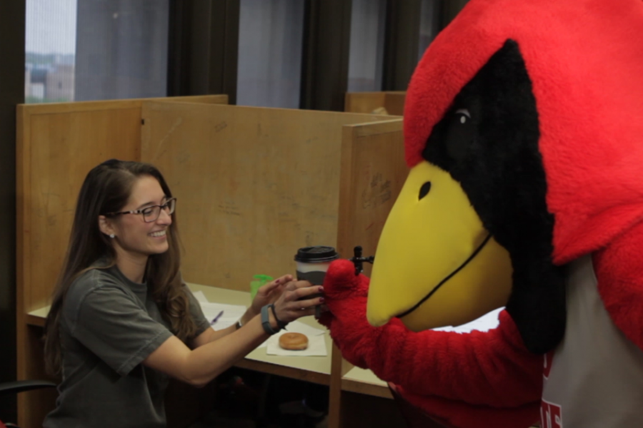 Reggie Redbird delivers coffee and donuts