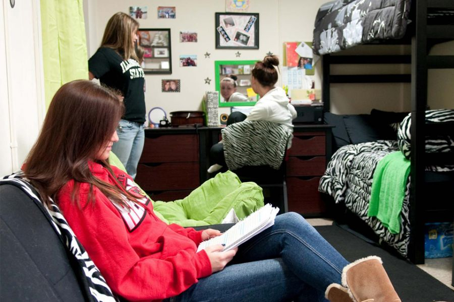 three girls sitting in room