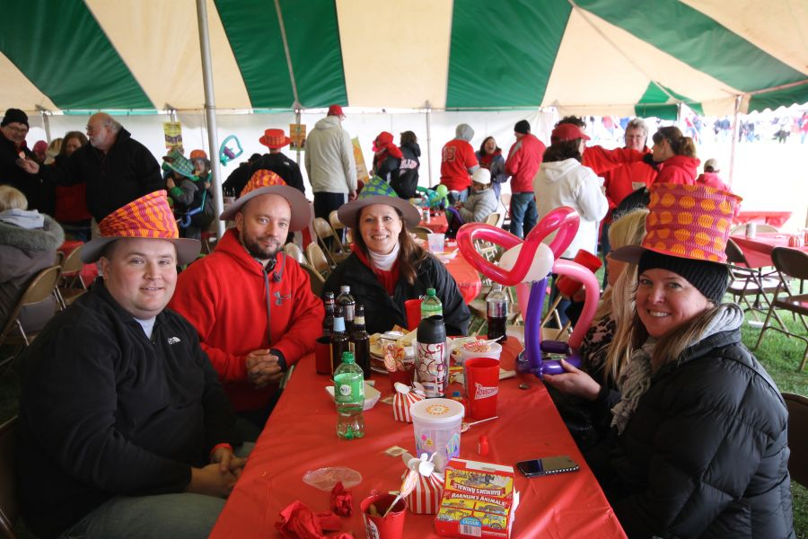 College of Education alumni, faculty, staff, and students #BackTheBirds at the College of Education's circus themed tailgate tent.