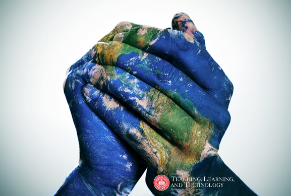 hands grasped together painted like a globe