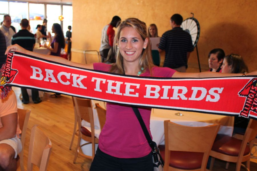 Girl holding Illinois State scarf
