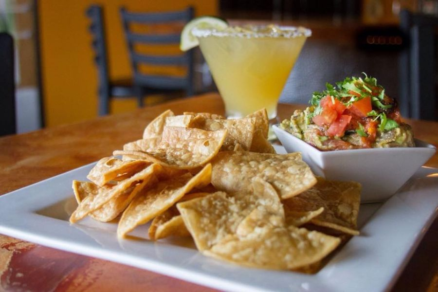 chips, guacamole, and drink