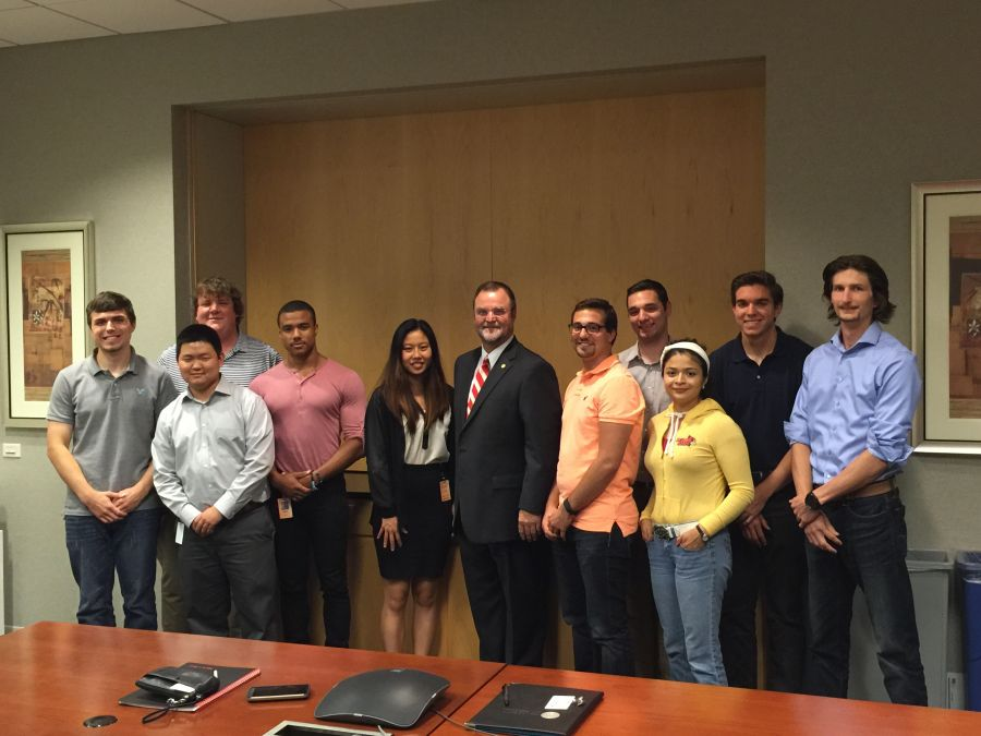 Jeff Wood poses with interns