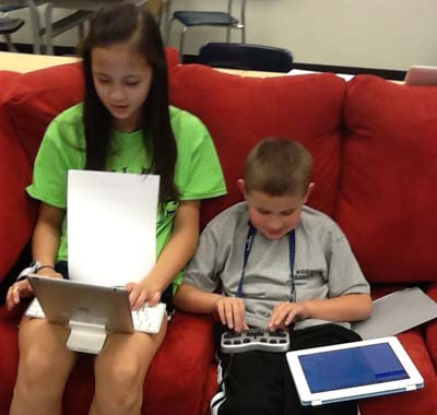 Children using technology to learn.
