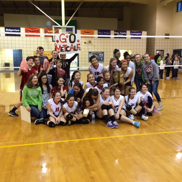 7th grade volleyball team poses