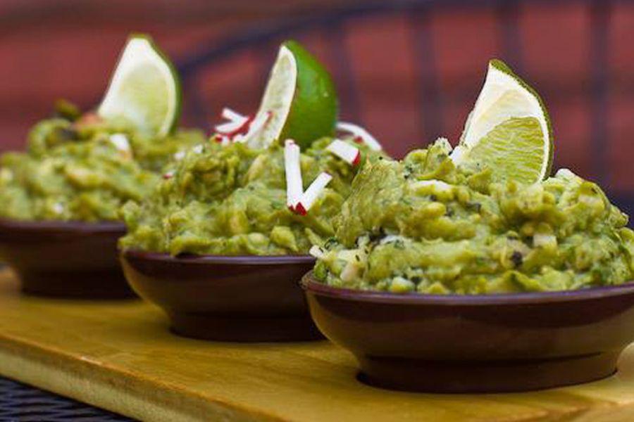 three bowls of guacamole