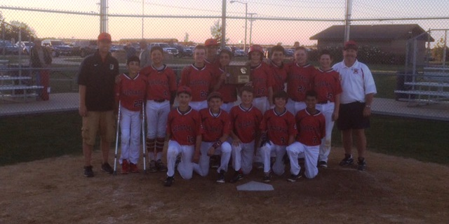 Baseball players pose for a picture after their win at regionals.