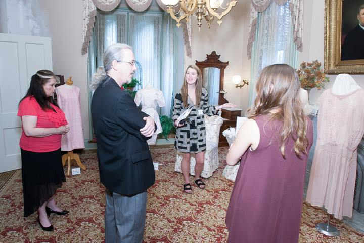Dr. Bill and Phoebe Anderson talk with Illinois State apparel, merchandising, and design student docents at the David Davis Mansion.