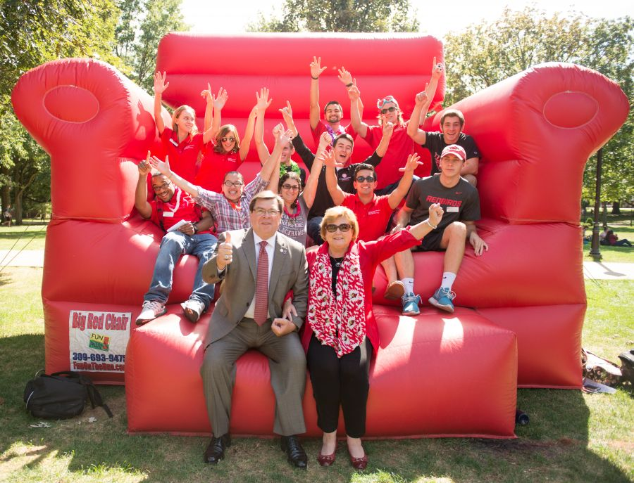 Dietz with students on red couch