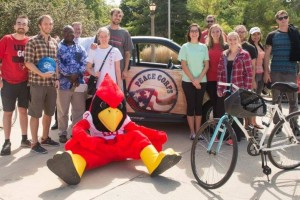 "Reggie Redbird and students with Peace Corps ""Peace Car"""