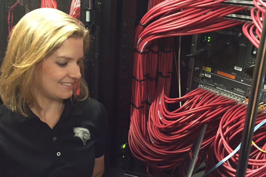 Rachel Roach in data center closet