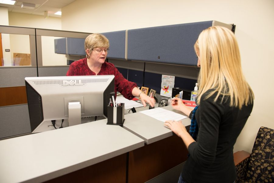 Student Health Insurance representative helps a student file a claim.