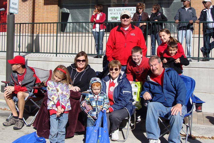 Young family at Homecoming parade