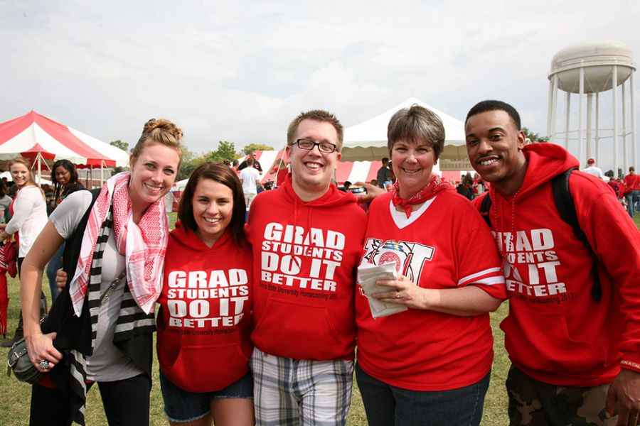 Faculty, staff, and students reconnect over some barbeque and drinks at the College of Education's 2014 tailgate tent.