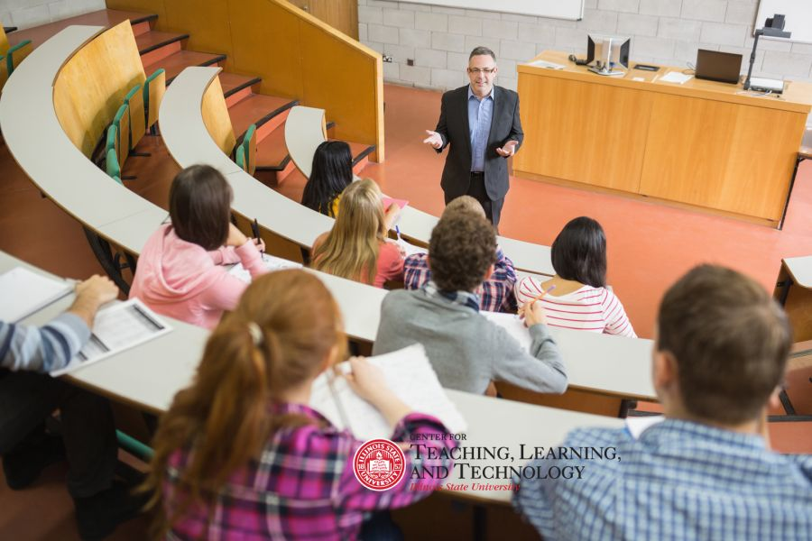 professor teaching in front of large class