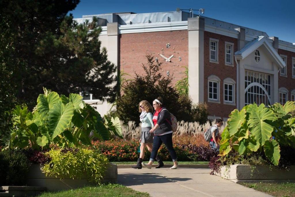 Students pass Schroeder Hall
