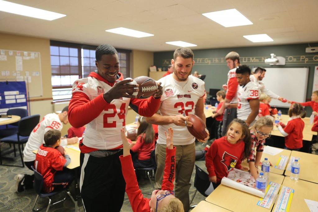 Redbird football players visit kids