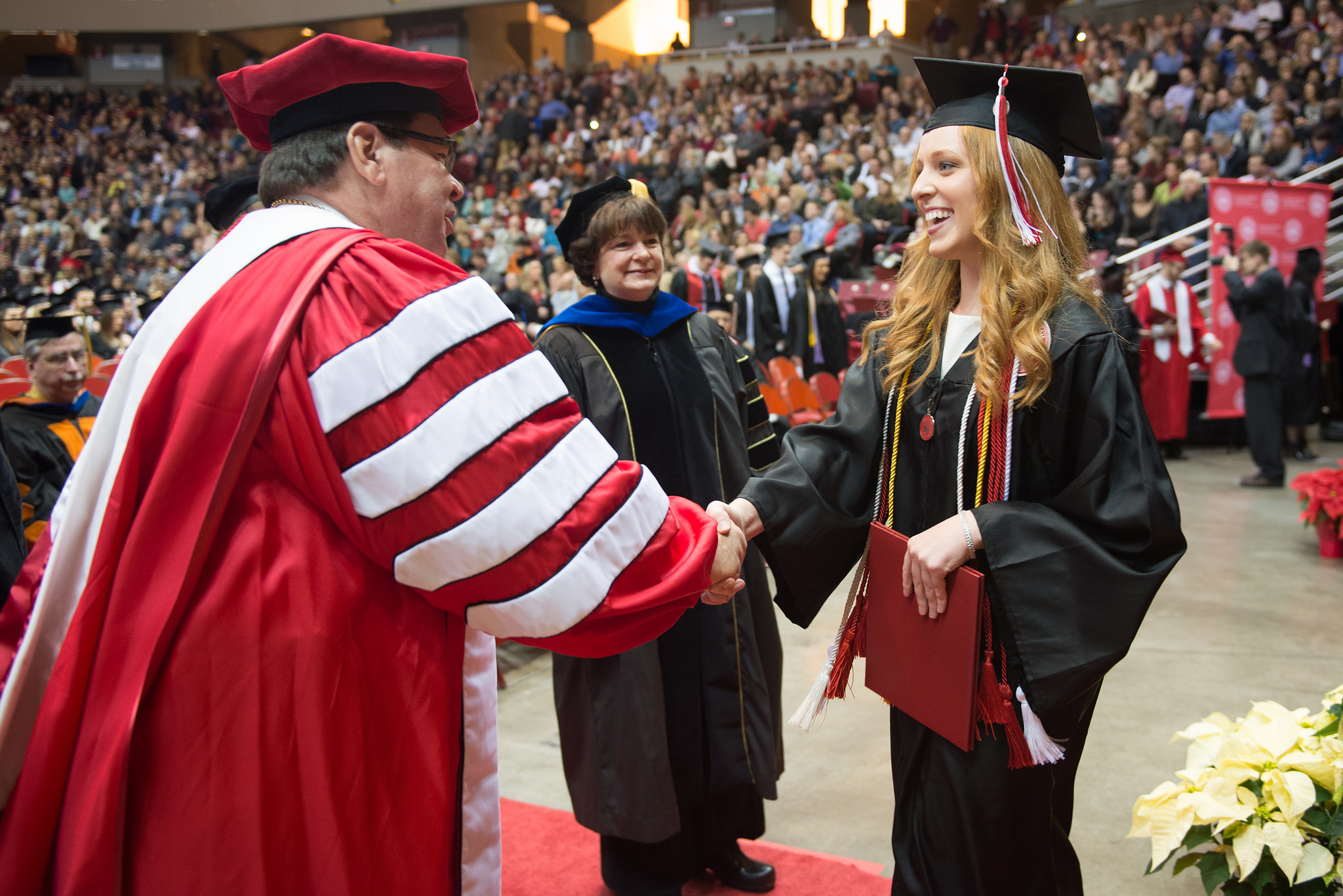 Dietz shakes new grad's hand