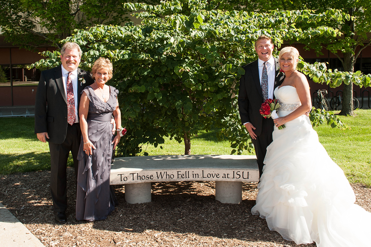 Two ISU couples pose at the bench