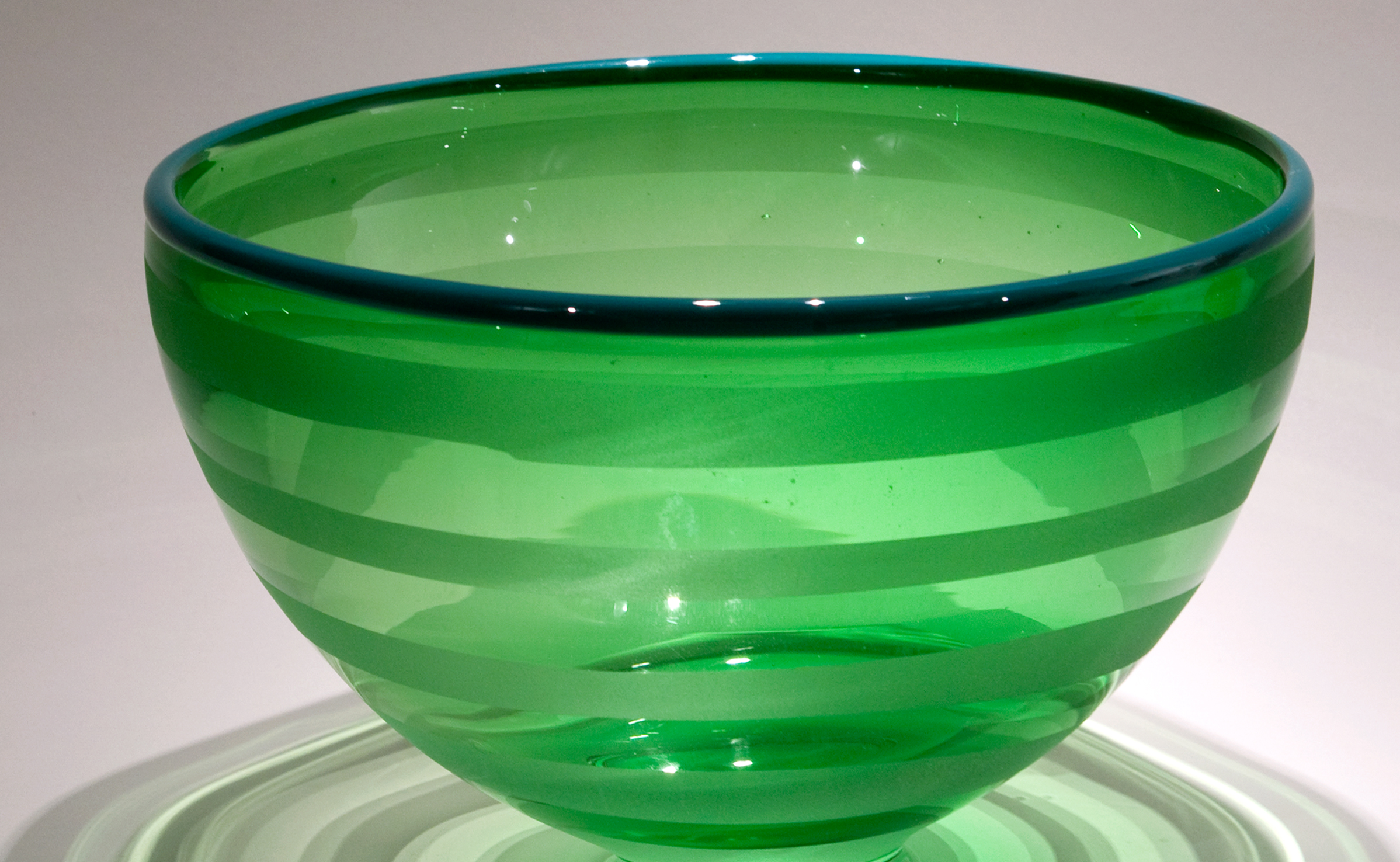 an image of a glass, green bowl from the Illinois State University Holiday Glass Sale