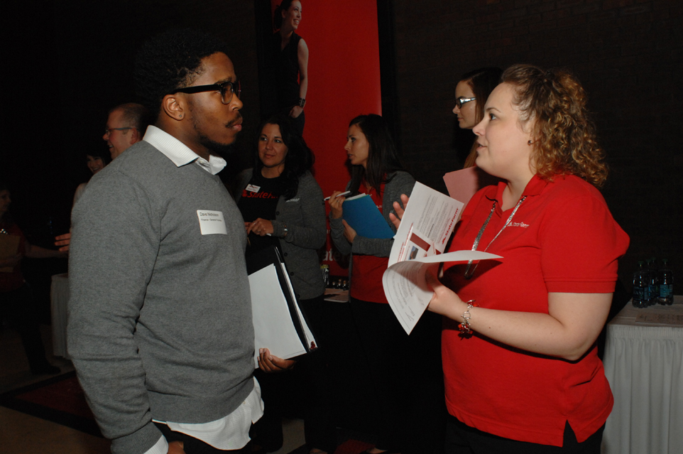 Student speaking with an employer