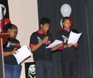 John G. Cook students perform their group poetry slam pieces.