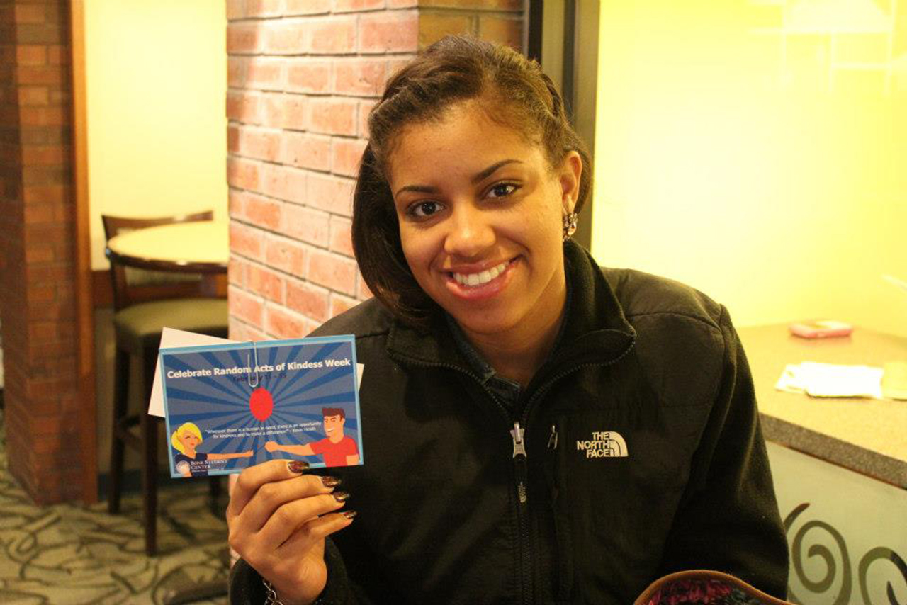 A student holding a card