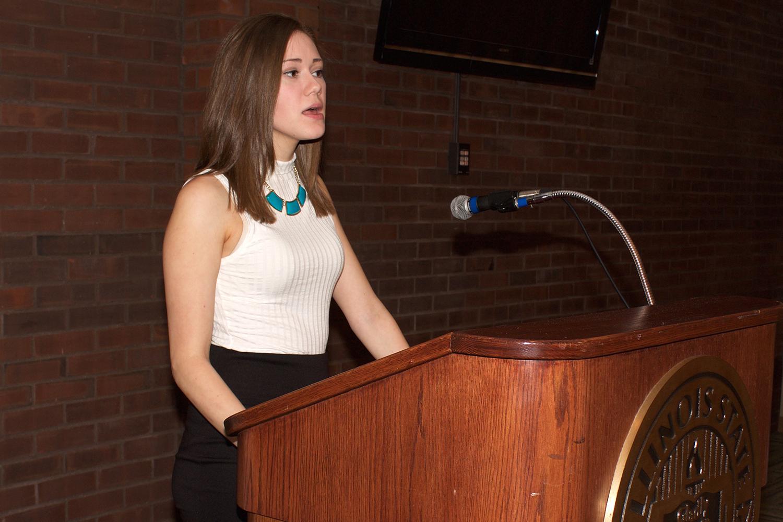 Sarah Hogan speaks at podium