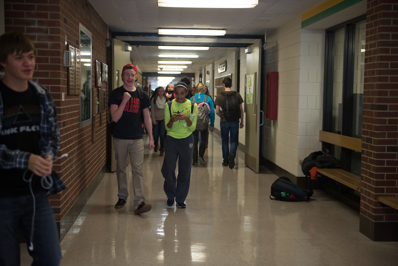 Two students in school hallway