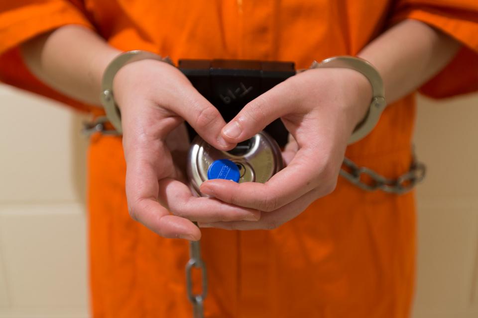Image of juvenile behind bars