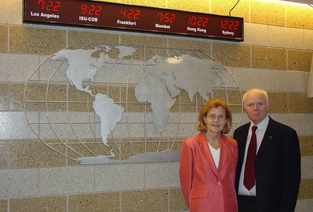 Iris and Carson Varner in front of the World Clock in the College of Business.