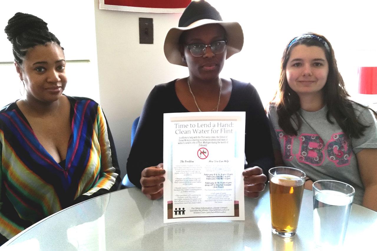Three students at table