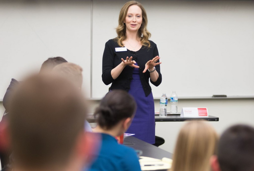 Woman speaking in front of class