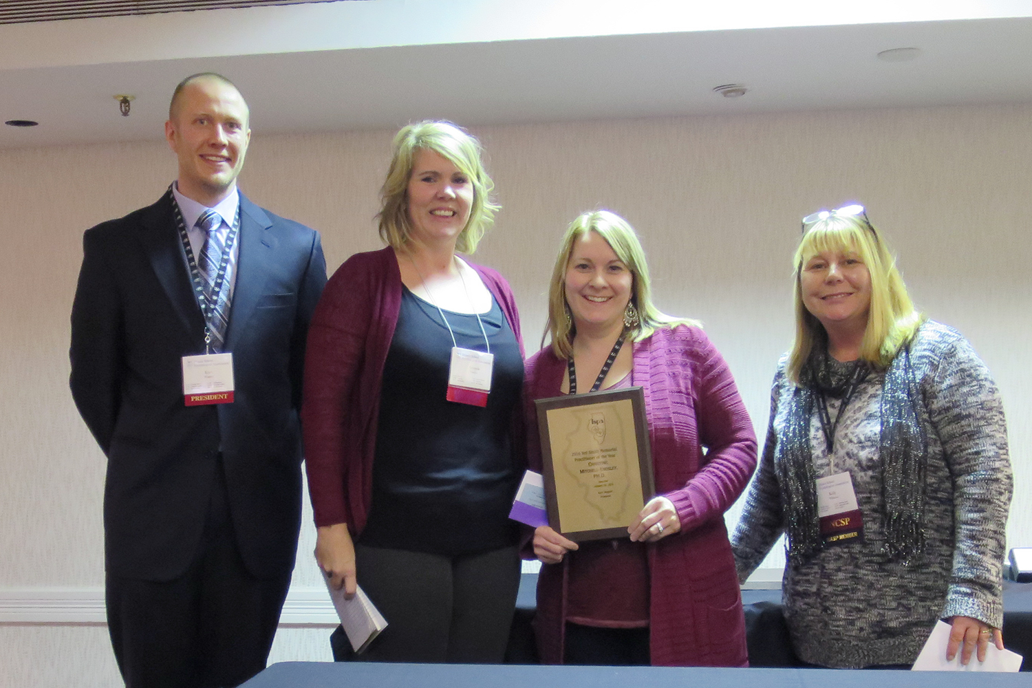 Christine Mitchell-Endsley with her peers and award