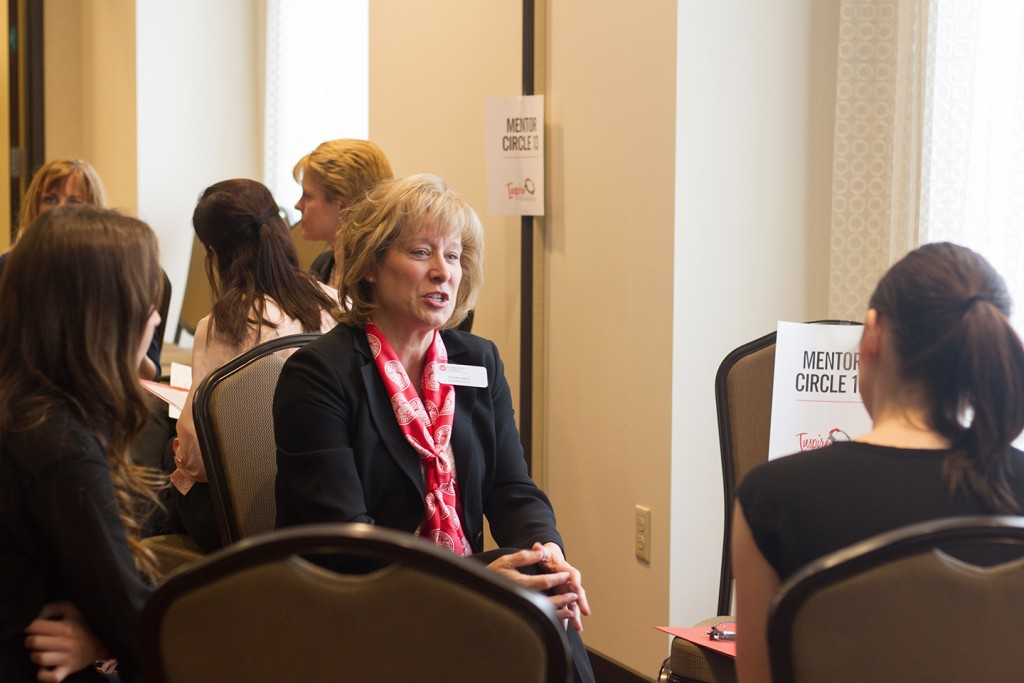 mentor speaks with students