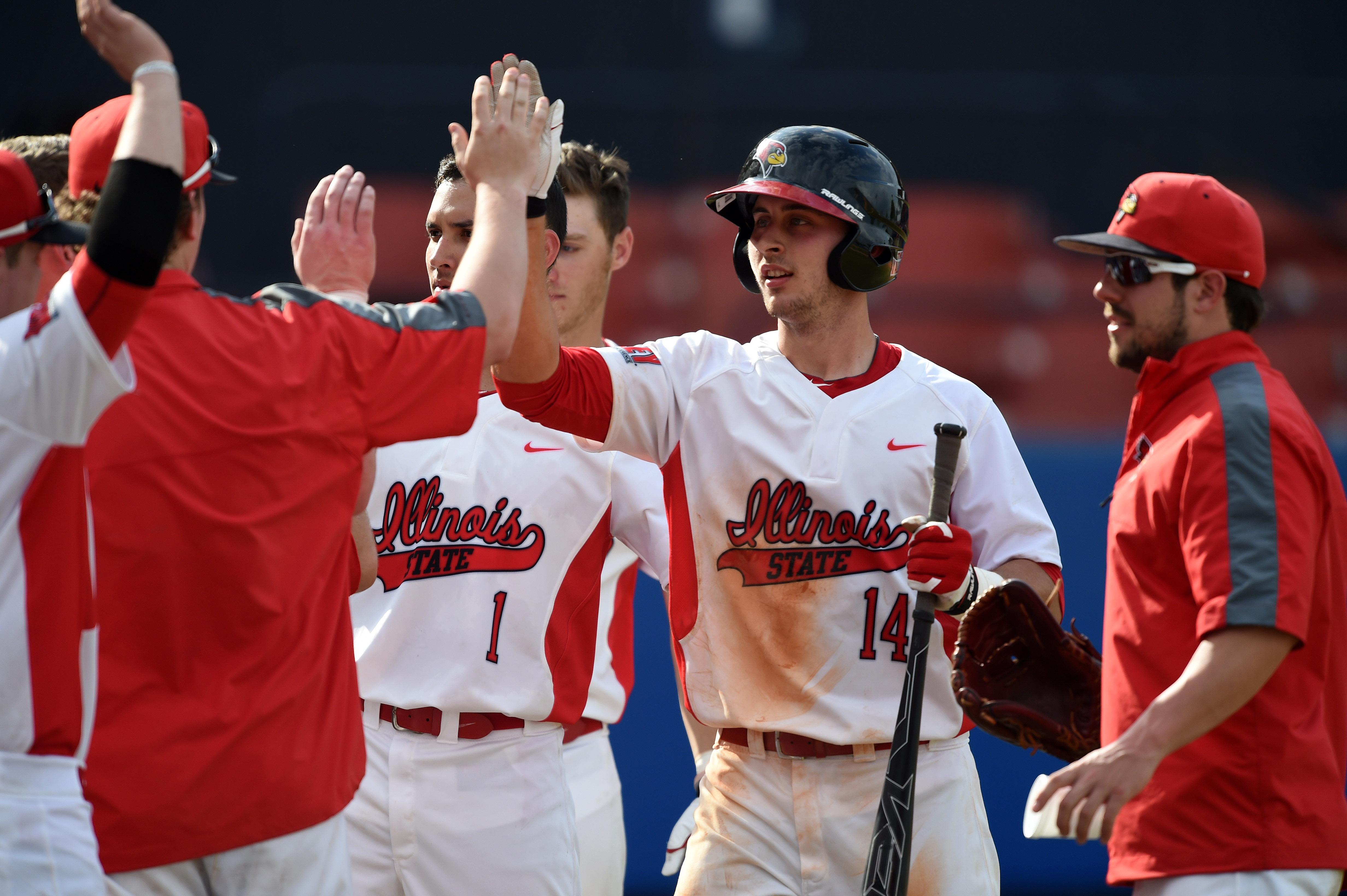 Paul DeJong high-fives teammates