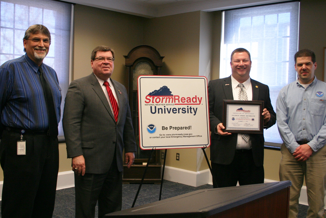 Photo of Chris Miller, National Weather Service; President Larry Dietz; Eric Hodges, University emergency manager; and Patrick Bak, National Weather Service