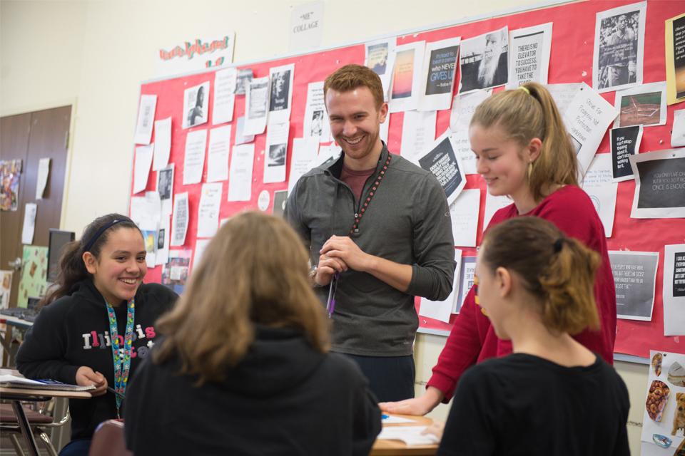 Blake Slutz '15 works with his students