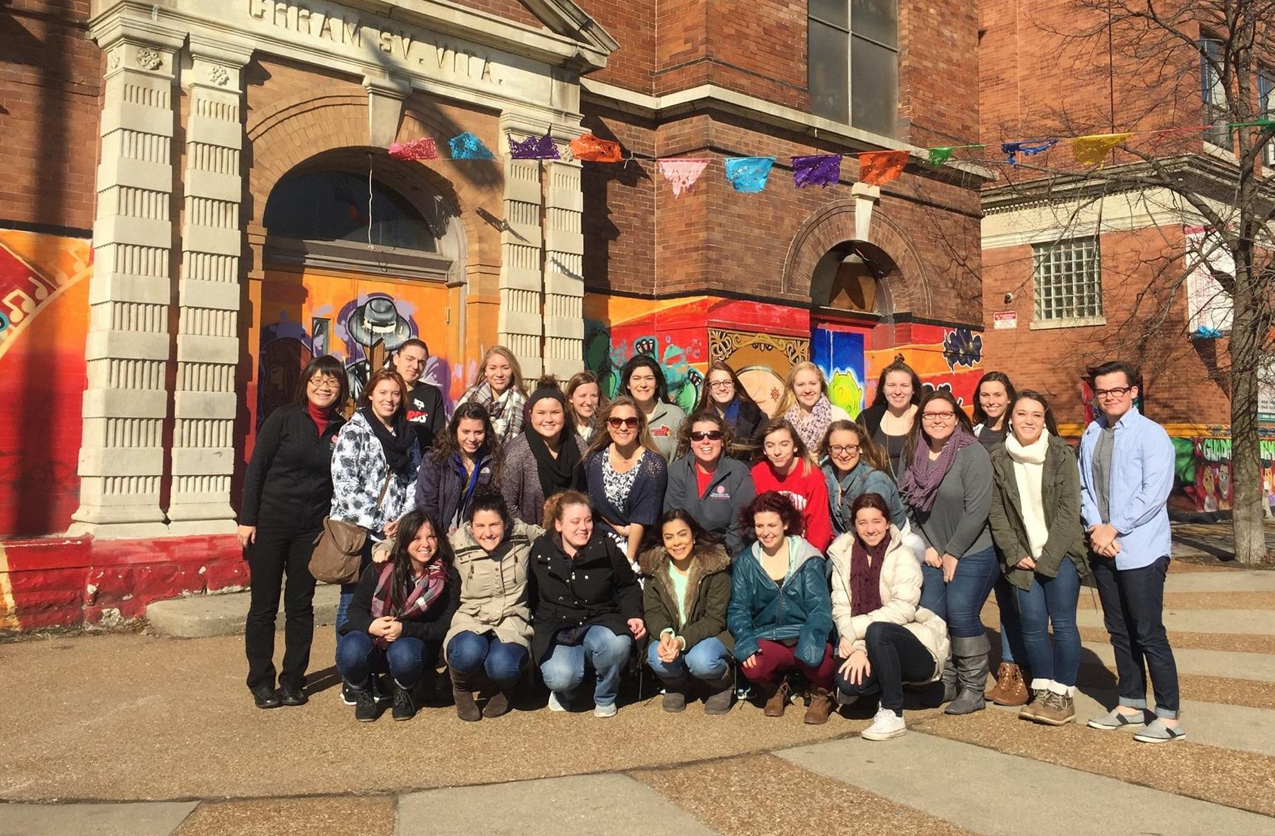 ISU students pose in Pilsen