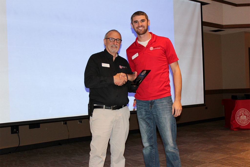 Junior Cole Hasselbring receives the Student Employee of the Year award from Assistant Director of the Bone Student Center Patrick O'Connell.
