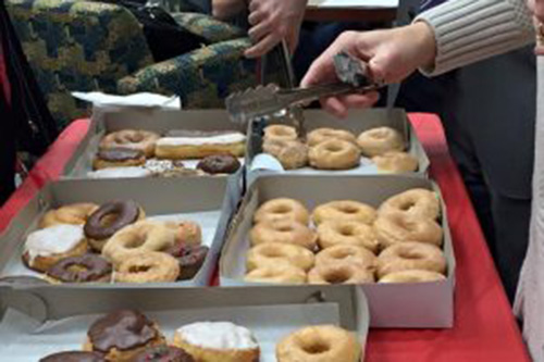 doughnuts in boxes on table