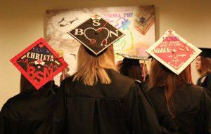 Mennonite College of Nursing graduates mortarboards