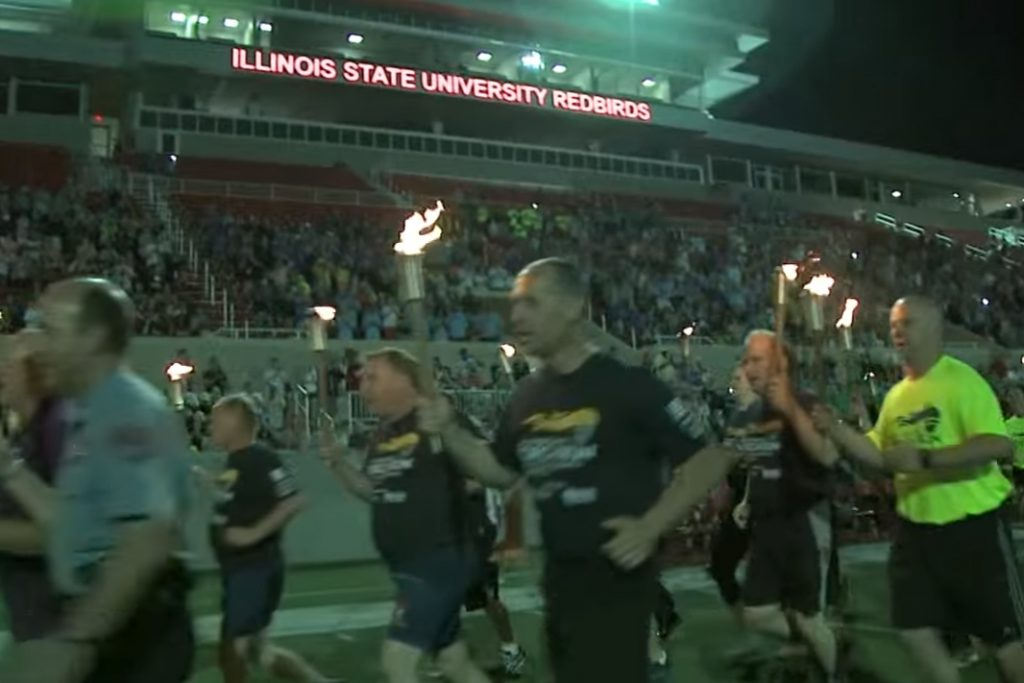 Runners with torches arrive at Hancock