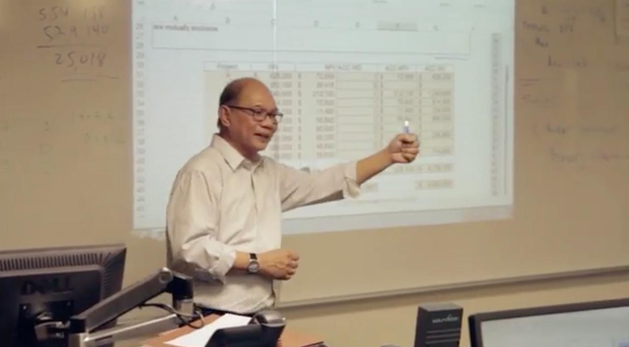 Professor teaching in the actuarial program