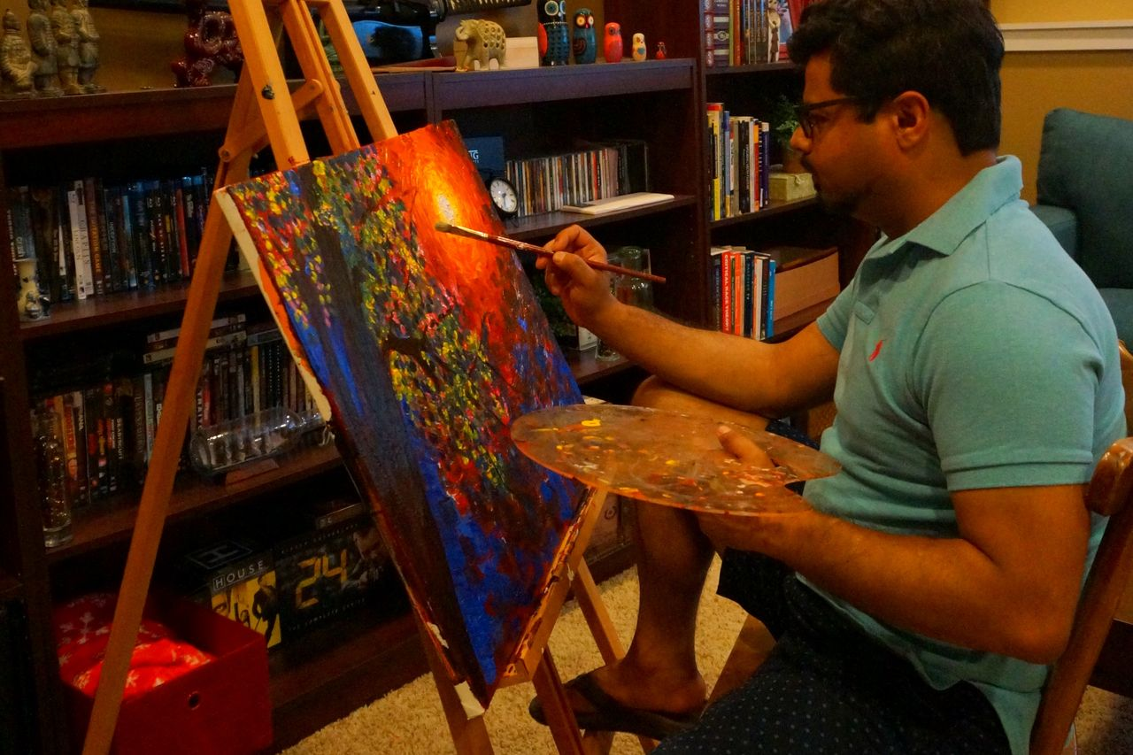 Avi Datta at work on a painting
