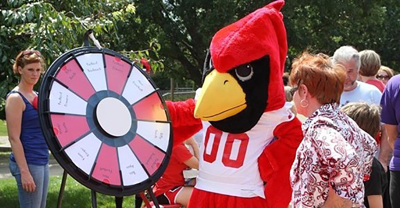 Reggie with attendees of past Redbird Fan Fair.