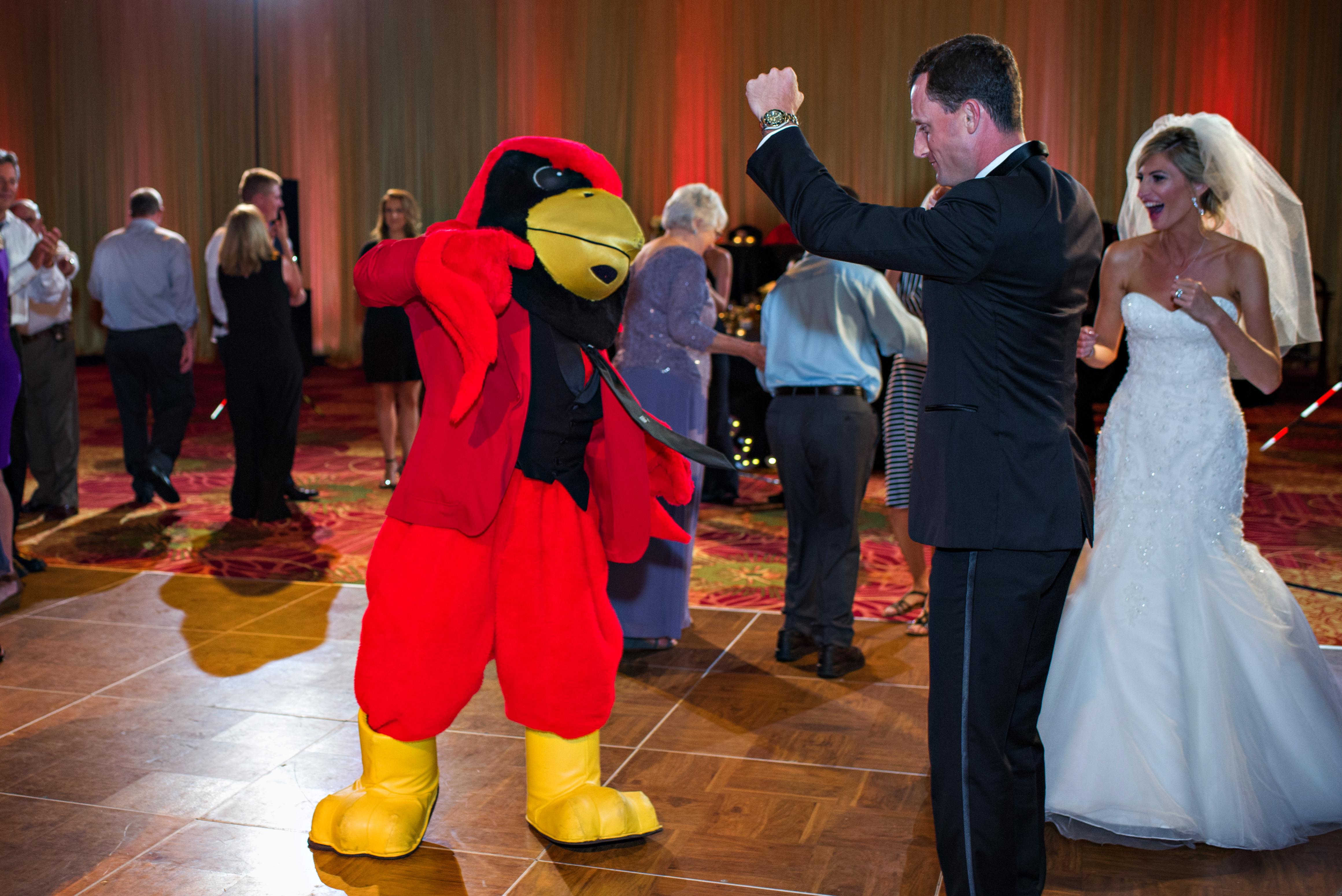 Joe and Casey join Reggie Redbird on the dance floor.