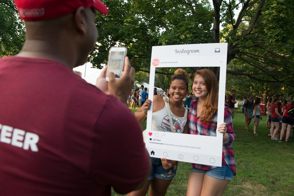 Students pose in Instagram cutout
