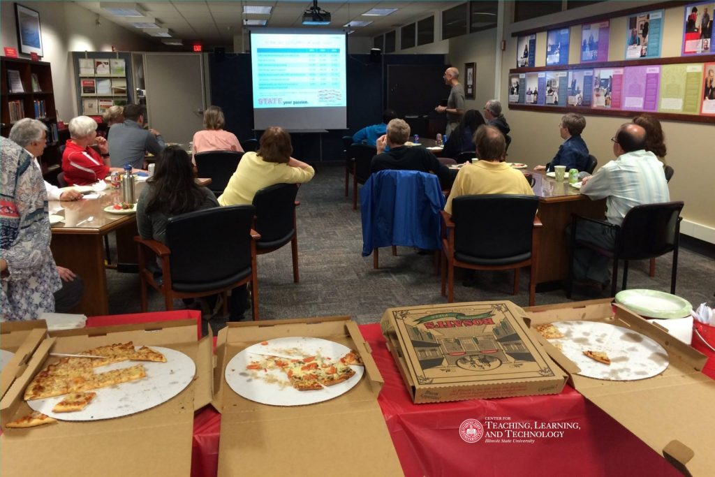 Faculty and staff in a workshop with pizza!